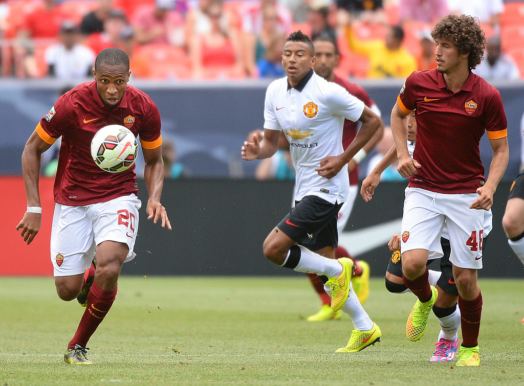 . AS Roma midfielder Seydou Keita (20) started a run with the ball in the second half. Manchester United defeated AS Roma 3-2 in an exhibition soccer game at Sports Authority Field in Denver Saturday afternoon, July 27, 2014. Photo by Karl Gehring/The Denver Post