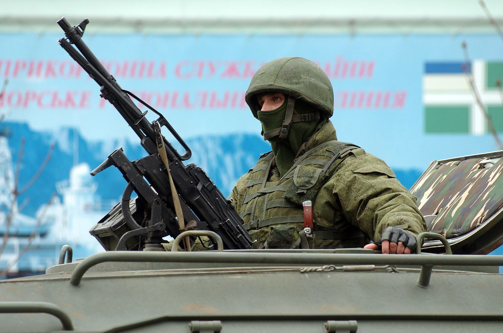 ". An unidentified armed individual in an armoured vehicle blocks the base of the Ukrainian border guard service in Sevastopol, on March 1, 2014. Ukraine\'s border guard service said on March 1 that about 300 armed men were attempting to seize its main headquarters in the Crimean port city of Sevastopol under orders from Russian Defense Minister Sergei Shoigu. ""The head of this group said that there are orders from the Russian defense minister to seize this naval post,\"" Ukraine\'s border guard service said in a statement, adding that the men wore \""full battle fatigues\"". AFP PHOTO/ VASILIY BATANOV/AFP/Getty Images"