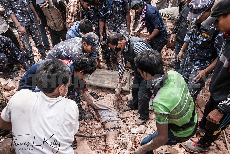 Rescuers dig through the rubble to recover bodies in the after math of the 7.9 magnitude earthquake that struck Nepal on Saturday.