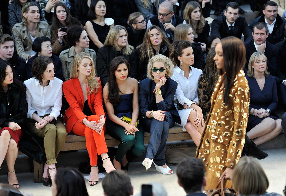 Description of . (L-R) Vicki Zhao, Michelle Dockery, Rosie Huntington-Whiteley, Freida Pinto, Rita Ora, Kate Beckinsale and Lily Mo Sheen sit in the front row for the Burberry Prorsum Autumn Winter 2013 Womenswear show on February 18, 2013 in London, England.  (Photo by Gareth Cattermole/Getty Images for Burberry)