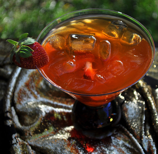 Photograph of iS Ice Baby summer cocktail a refreshing summer drink made with ultra-premium iS Vodka. iS Ice Baby is made with iS Vodka, Chi-Devil Elixir, Red Bull, Fresh Lime Juice and Pressed Strawberries. Strawberry garnish.
