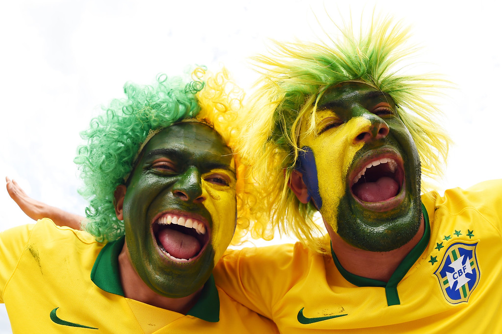 . Brazil fans enjoy the atmosphere prior to kickoff during the 2014 FIFA World Cup Brazil Semi Final match between Brazil and Germany at Estadio Mineirao on July 8, 2014 in Belo Horizonte, Brazil.  (Photo by Jamie McDonald/Getty Images)