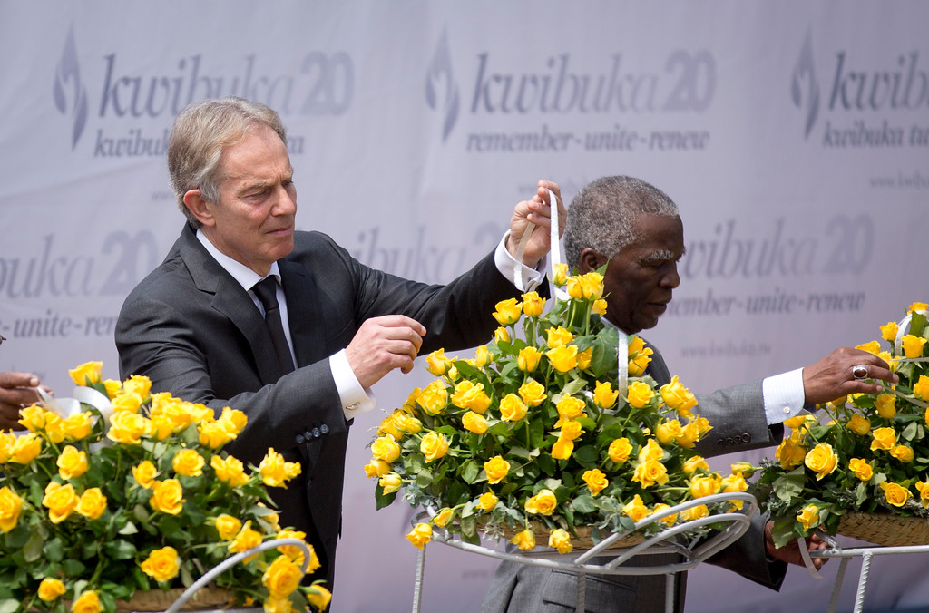 . Former British Prime Minister Tony Blair, left, and Former South African President Thabo Mbeki, right, lay a memorial wreath at a ceremony to mark the 20th anniversary of the Rwandan genocide, held at the Kigali Genocide Memorial Center in Kigali, Rwanda Monday, April 7, 2014. (AP Photo/Ben Curtis)