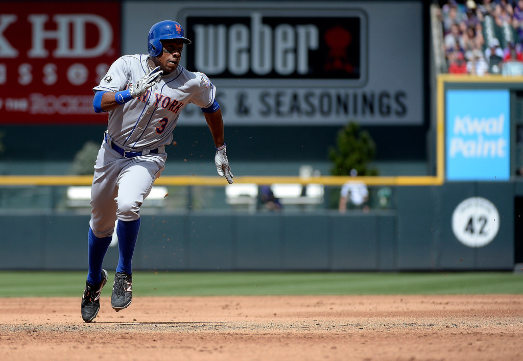 . New York Mets right fielder Curtis Granderson (3) rounds second on his way to third base on a New York Mets left fielder Chris Young (1) double in the third inning May 4, 2014 at Coors Field. (Photo by John Leyba/The Denver Post)