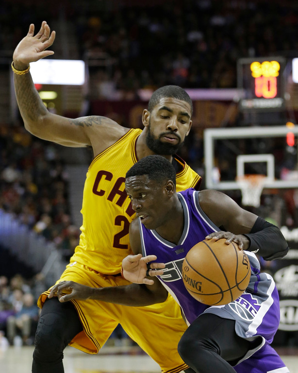 . Sacramento Kings\' Darren Collison drives against Cleveland Cavaliers\' Kyrie Irving during the first half of an NBA basketball game, Wednesday, Jan. 25, 2017, in Cleveland. (AP Photo/Tony Dejak)