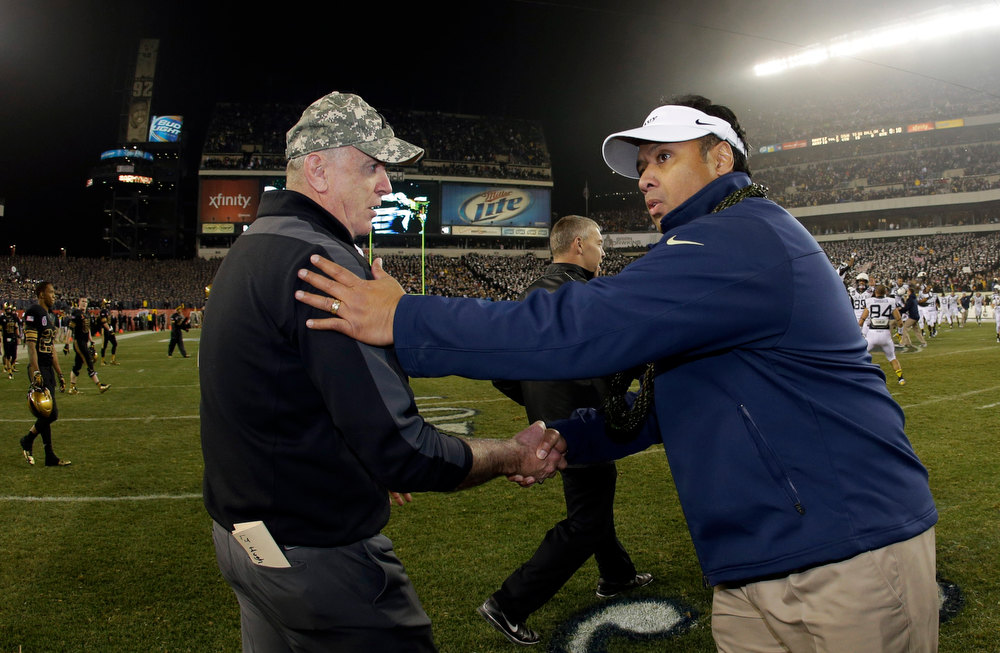 Description of . Navy head coach Ken Niumatalolo, right, greets Army head coach Rich Ellerson after their NCAA college football game, Saturday, Dec. 8, 2012, in Philadelphia. Navy won 17-13. (AP Photo/Matt Slocum)