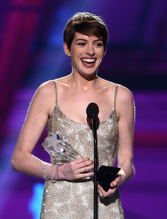 """. Anne Hathaway accepts the award for best supporting actress for \""""Les Miserables\"""" at the 18th Annual Critics\' Choice Movie Awards at the Barker Hangar on Thursday, Jan. 10, 2013, in Santa Monica, Calif.  (Photo by Matt Sayles/Invision/AP)"""