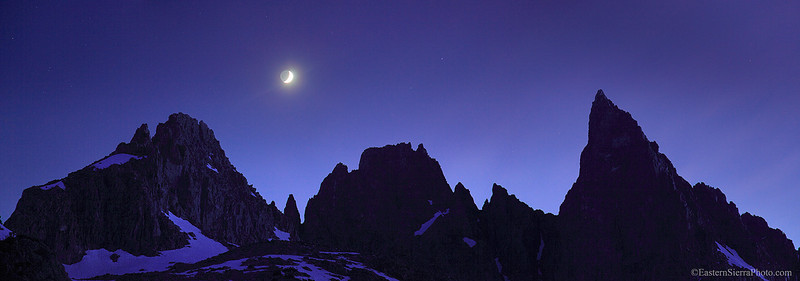 The Minarets from left to right Kehrlein, Ken and the Southeast Face of Clyde under an early evening sky with the crescent moon directly over the South Notch.  Ansel Adams Wilderness, Eastern Sierra.