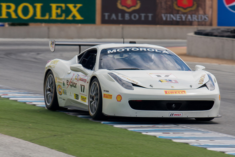 Patrick Byrne runs on the curb as he races  down the front straight in the #17 Ferrari 458 EVO. © 2014 Victor Varela