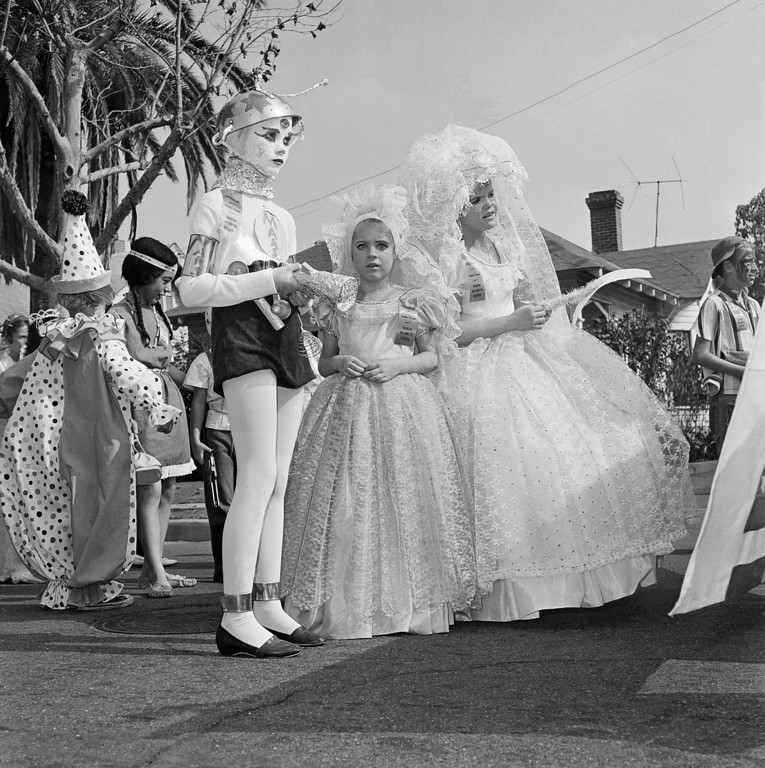 . Pictured here is the Halloween festival in Anaheim, Calif., Oct. 20, 1962. Nearly everyone  turns out to watch the parade, and thousands are on hand to watch the show that launches it at the Palma Stadium. Another 7,000 or more school children take part in a youngsters\' parade and there is breakfast for 2,000 costumed citizens.  (AP Photo)