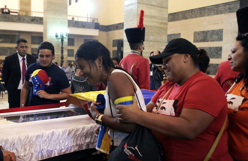 . A woman reacting as she pays last tribute to the late Venezuelan President Hugo Chavez, at the Military Academy chapel on March 7, 2013 in Caracas. Venezuelans filed past the open casket of late President Hugo Chavez as he lay in state after throngs of weeping loyalists gave the firebrand leftist a rousing farewell on the streets on the eve.  AFP PHOTO/PRESIDENCIA-Efrain GONZALEZ