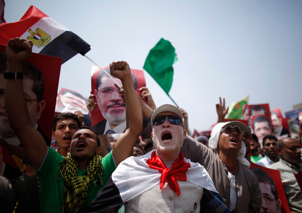 . Supporters of Egyptian President Mohamed Mursi shout slogans during a protest to show support to him at the Raba El-Adwyia mosque square in Cairo July 3, 2013. At least 16 people were killed on Wednesday and 200 wounded when gunmen opened fire on supporters of President Mohamed Mursi who were rallying outside Cairo University, state television quoted a Health Ministry spokesman as saying. REUTERS/Khaled Abdullah