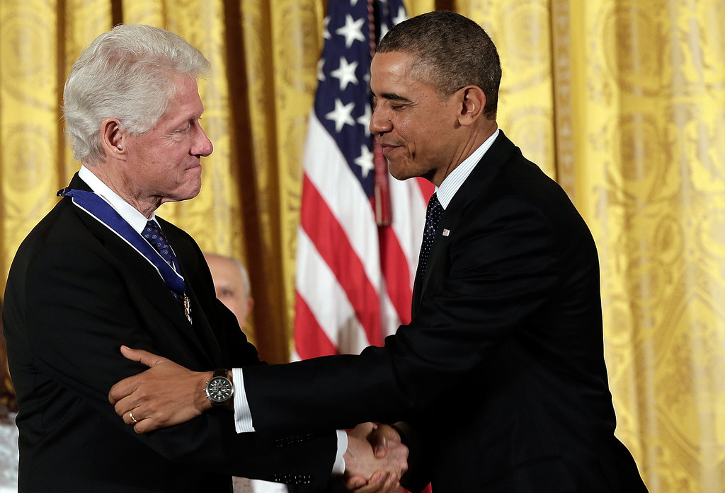 . U.S. President Barack Obama (R) congratulates former U.S. President Bill Clinton before awarding him the Presidential Medal of Freedom in the East Room at the White House on November 20, 2013 in Washington, DC.   (Photo by Win McNamee/Getty Images)