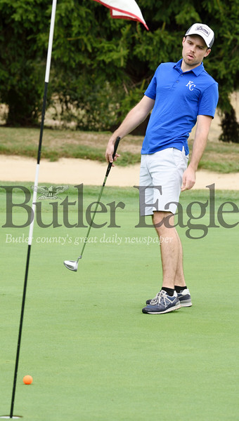 Harold Aughton/Butler Eagle: Christian Umbach attempts a little body english to make his putt at the Butler County Chamber of Commerce annual golf outing at Lake Arthur golf course.