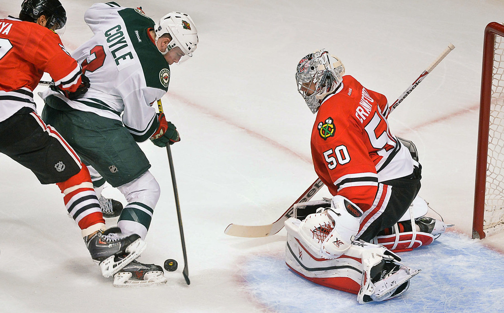 . Minnesota\'s Charlie Coyle bears down on Blackhawks goalie Corey Crawford during the first period.  (Pioneer Press: Ben Garvin)