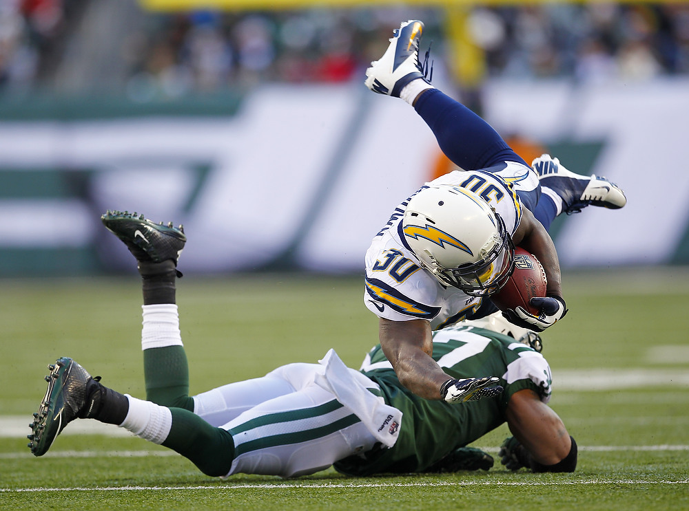 Description of . Running back Ronnie Brown #30 of the San Diego Chargers us upended by Yeremiah Bell #37 of the New York Jets during the first half in a game at MetLife Stadium on December 23, 2012 in East Rutherford, New Jersey. (Photo by Rich Schultz /Getty Images)