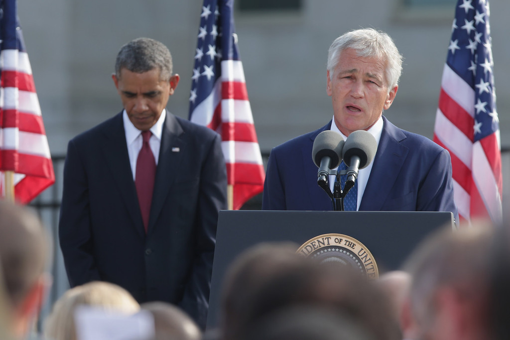 . U.S. Defense Secretary Chuck Hagel (R) speaks during a ceremony in observance of the terrorist attacks of 9/11 was U.S. ith President Barack Obama listens at the Pentagon September 11, 2013 in Arlington, Virginia.   (Photo by Chip Somodevilla/Getty Images)
