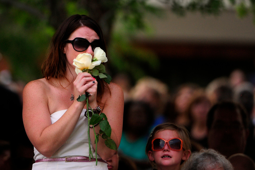 . Amanda Medek, sister of victim Micayla Medek cries during a community vigil in honor of the victims of the Aurora theater shooting at the Aurora Municipal Center on Sunday, July 22, 2012. AAron Ontiveroz, The Denver Post