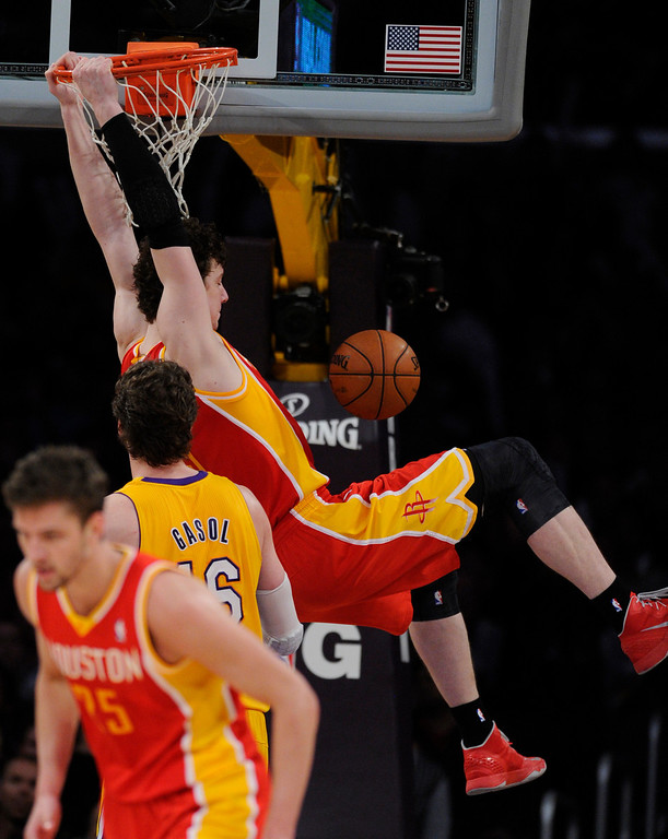 . Rockets#3 Omer Asik dunks the ball late in the 4th quarter. The Lakers defeated the Houston Rockets in overtime 99-95 in the final home game of the year at Staples Center in Los Angeles, CA 4/17/2013(John McCoy/Staff Photographer