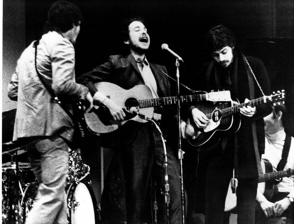 . 1968: In his first appearance since a motorcycle accident 17 months earlier, Bob Dylan, center, sings with the Crackers at Carnegie Hall Jan., 19, 1968. Dylan performed as part of a benefit tribute to folk singer-songwriter Woody Guthrie, who died of Huntington\'s disease the year before. Dylan\'s appearance ended rumors that he had died or injured his brain in the August 1966 accident. With Dylan are two members of the Crackers, a five piece rock group, Rick Danhko, left, and Robbie Robinson. (AP PHOTO)