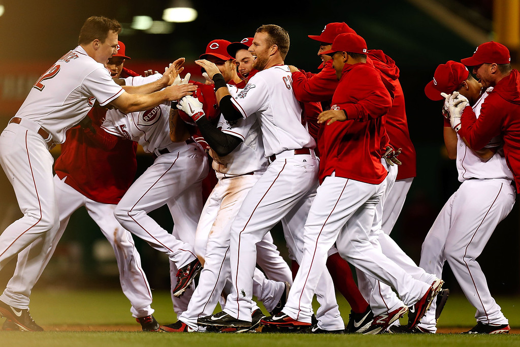. CINCINNATI, OH - SEPTEMBER 23:  Shin-Soo Choo #17 of the Cincinnati Reds is congratulated by his teammates after hitting a walk-off double to defeat the New York Mets 3-2 in the 10th inning at Great American Ball Park on September 23, 2013 in Cincinnati, Ohio. (Photo by Kirk Irwin/Getty Images)