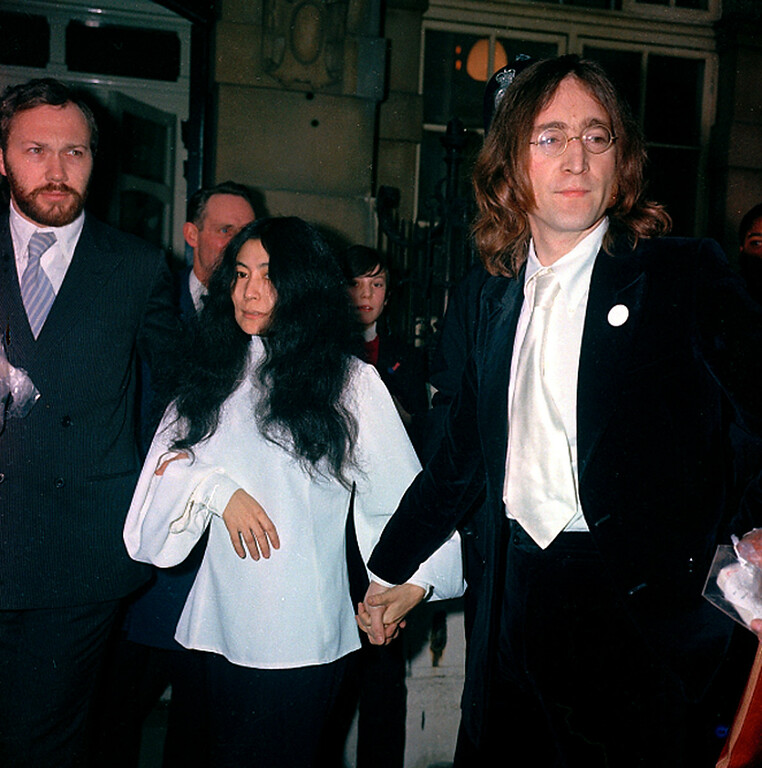 . Beatle John Lennon, right, and companion Yoko Ono are arrested for possession of marijuana after their flat was raided in London, England, on Oct. 18, 1968.  (AP Photo/Boyton)