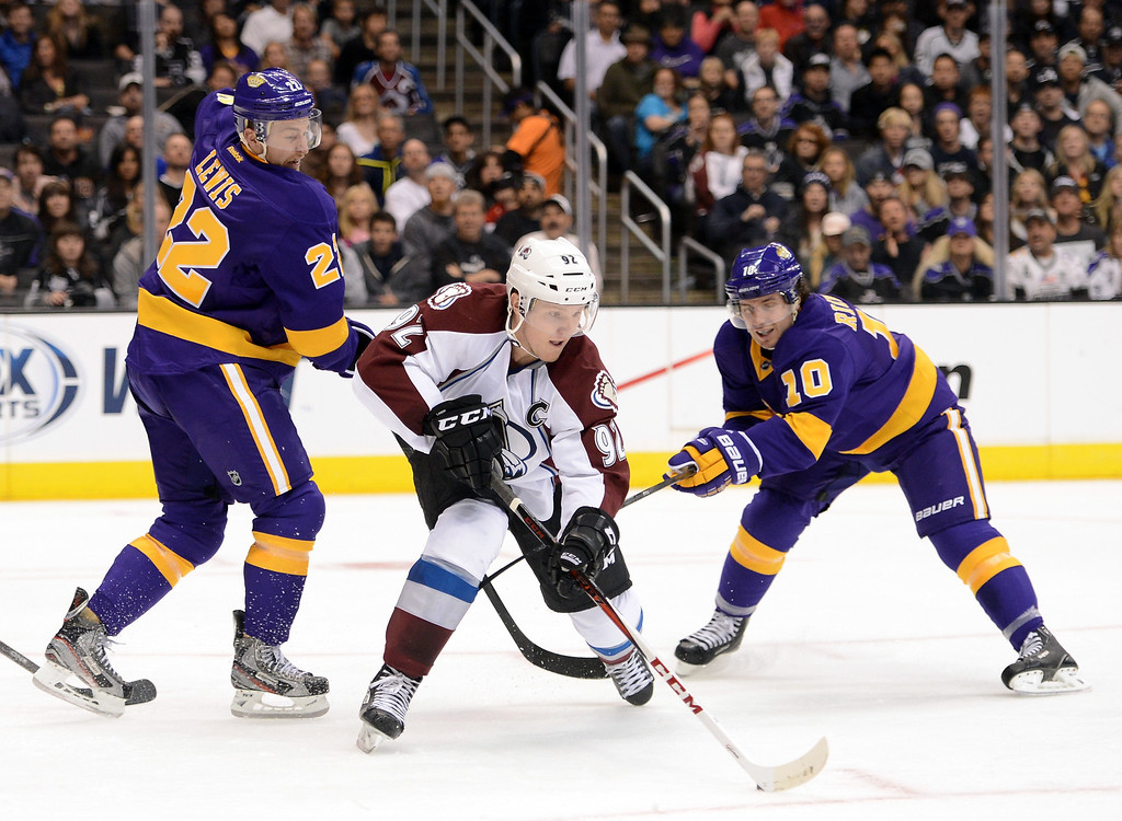 . LOS ANGELES, CA - FEBRUARY 23:  Gabriel Landeskog #92 of the Colorado Avalanche controls a rebound away from Trevor Lewis #22 and Mike Richards #10 of the Los Angeles Kings during the second period at Staples Center on February 23, 2013 in Los Angeles, California.  (Photo by Harry How/Getty Images)