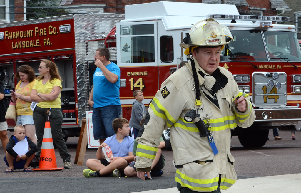 . Fairmount Fire Chief Joe Stockert officiates a water battle demonstration as part of the Fairmount Fire Company 125th Anniversary festivities during the Lansdale Founders Day celebration on Saturday August 23,2014. Photo by Mark C Psoras/The Reporter