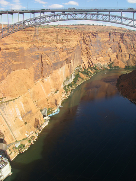 Glen Canyon Dam is a concrete arch dam on the Colorado River in northern Arizona, just north of Page. The dam was built in 10 years (1956 – 1966) forming Lake Powell - the second largest artificial lake in US.