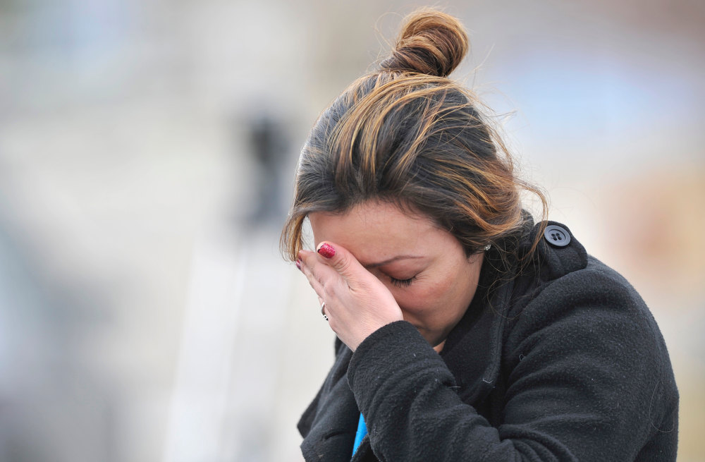 . An unidentified woman wipes tears from her eyes after talking to a Weld County Sheriffs deputy, Tuesday, Dec. 18, 2012, in Longmont. (Matthew Jonas/Times-Call)