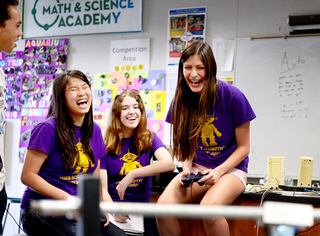""". From left, Amanda Sullivan, 17, Emma McIntosh, 16, and Jordan Nuñez, 17, of The King and Queens, of Monrovia High\'s Robotics, react as their robot \""""Your Heiness\"""" works the field as they practice for the World Championships Tuesday, April 8, 2014. The King and Queens, an all girl team, qualified to advance to the 2014 First Tech Challenge Robotics World Championships after competing in the West Super-Regional Robotics Tournament at McClellan Air Force Base this past weekend. The Monrovia team, the only qualifier from the Los Angeles area, joins three San Diego teams and four Northern California teams to be among the 128 top teams from around the world to compete at the First Robotics World Championships. (Photo by Sarah Reingewirtz/Pasadena Star-News)"""