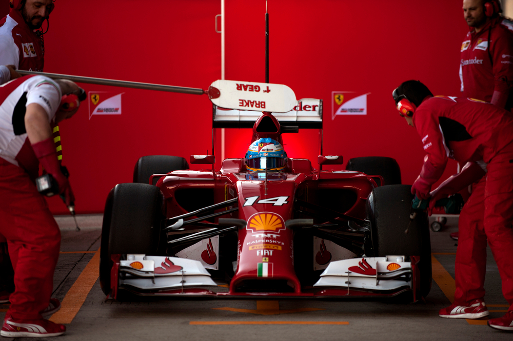 . Ferrari Spanish driver Fernando Alonso sits in his car during the Formula One pre-season test days at Jerez racetrack in Jerez on January 30, 2014. (Jorge Guerrero/AFP/Getty Images)
