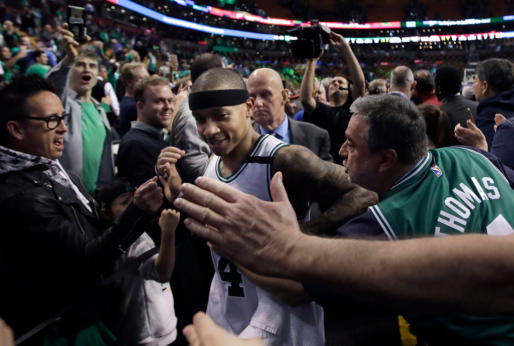 . Fans congratulate Boston Celtics guard Isaiah Thomas after Game 7 of a second-round NBA basketball playoff series, Monday, May 15, 2017, in Boston. The Celtics won 115-105 to advance to the Eastern Conference championship series. (AP Photo/Charles Krupa)
