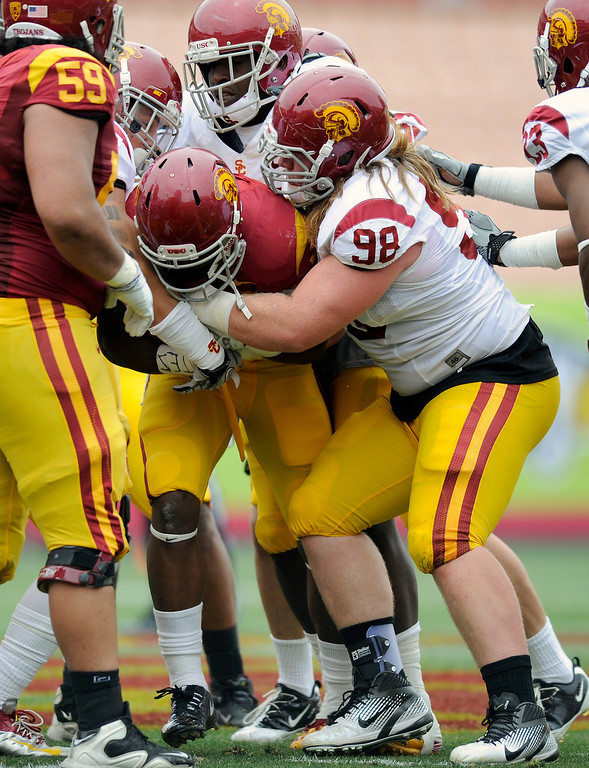 . DT Cody Temple (#98) wraps up RB Javorius Allen at USC\'s Spring Football Game. (Michael Owen Baker/Staff Photographer)