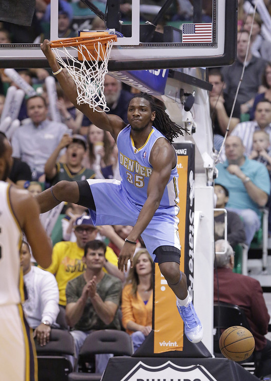 . Denver Nuggets\' Kenneth Faried (35) hangs from the rim after dunking the ball in the third quarter during an NBA basketball game against the Utah Jazz ,Wednesday, April 3, 2013, in Salt Lake City. The Nuggets defeated the Jazz 113-96.  (AP Photo/Rick Bowmer)