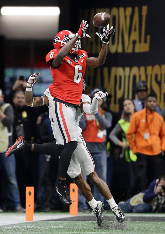 . Georgia wide receiver Javon Wims catches a pass in front of Alabama\'s Anthony Averett during the first half of the NCAA college football playoff championship game Monday, Jan. 8, 2018, in Atlanta. (AP Photo/David J. Phillip)