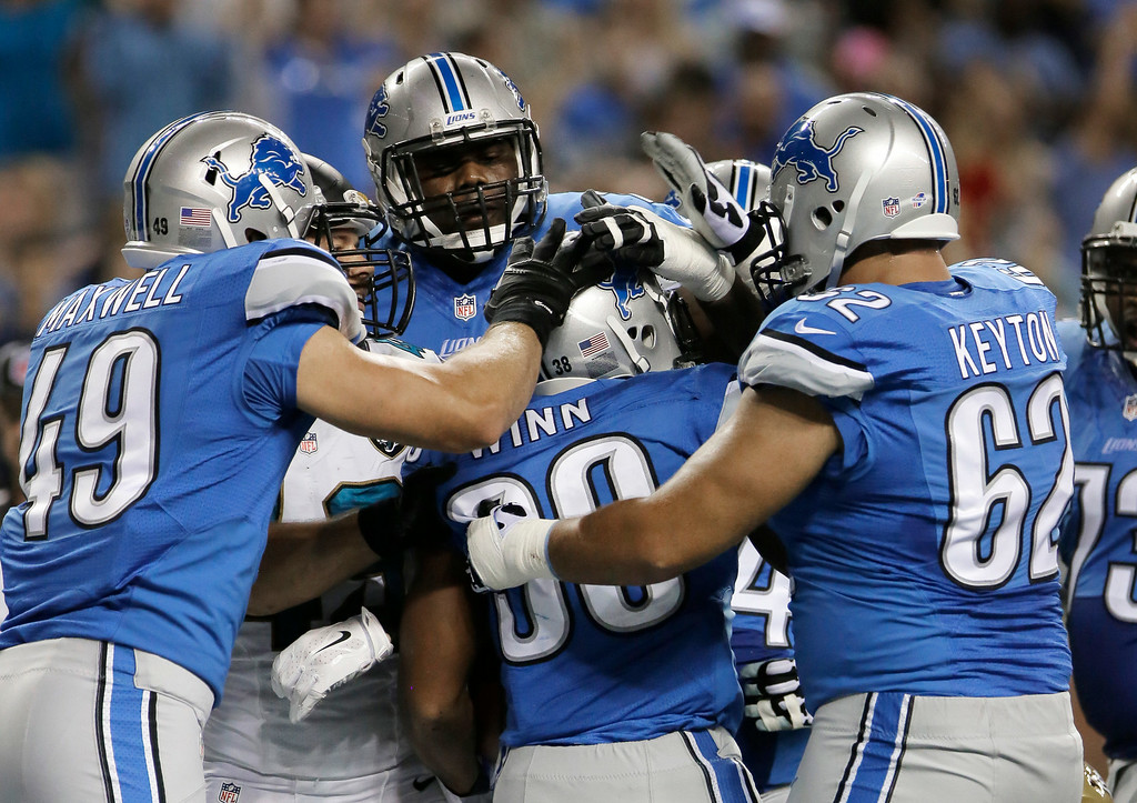 . Detroit Lions running back George Winn (38) celebrates his one-yard touchdown run against the Jacksonville Jaguars in the second half of a preseason NFL football game at Ford Field in Detroit, Friday, Aug. 22, 2014.  (AP Photo/Duane Burleson)
