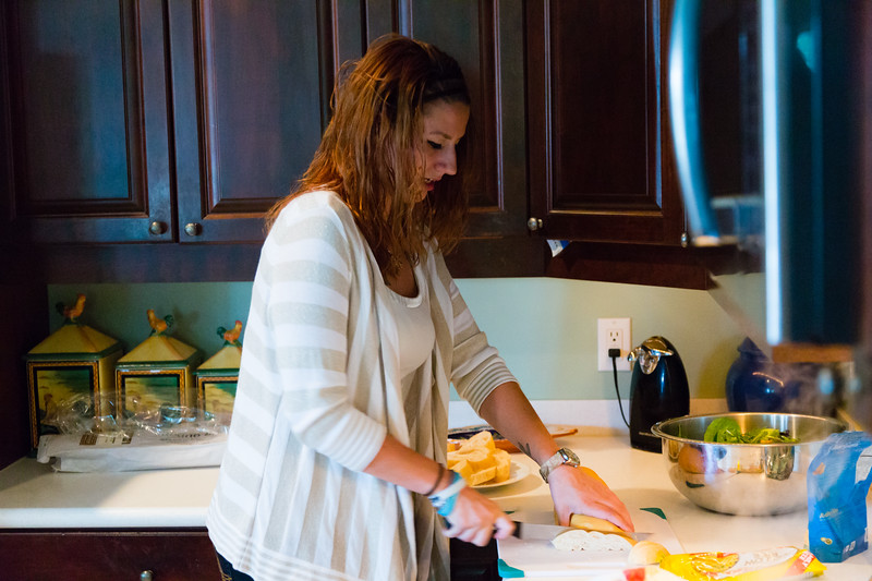 Shelby Sparrow, 21, of Plantation, Florida,  slices cuban bread that will go with the dinner she is cooking for the residents of All About Recovery's younger women's sober home in Loxahatchee, Florida on Wednesday, June 1, 2016. Sparrow, a recovering heroin addict has been in the sober home since February 2016 and has been clean for five months. (Joseph Forzano / The Palm Beach Post)