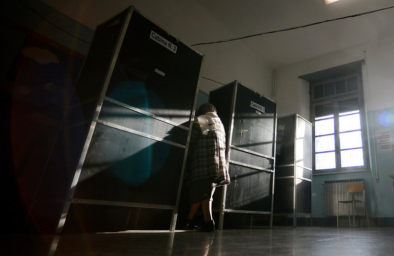 . A woman enters a voting booth in a polling station in Rome on February 24, 2013, as part of Italy\'s general elections. Italians fed up with austerity voted in the country\'s most important election in a generation, as Europe held its breath for signs of fresh instability in the eurozone\'s third economy.  FILIPPO MONTEFORTE/AFP/Getty Images