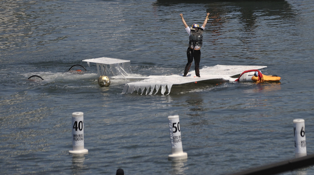 """. LONG BEACH, CALIF. USA -- Amber Cowan celebrates after piloting \""""The Flight of the Spruce Goose 2.0\"""" during the Flugtag in Rainbow Harbor in Long Beach, Calif. on August 21, 2010. Thirty five teams competed in the Red Bull event where teams build homemade, human-powered flying machines and pilot them off a 30-foot high deck in hopes of achieving flight.  Flugtag means \""""flying day\"""" in German. They are on distance, creativity and showmanship..Photo by Jeff Gritchen / Long Beach Press-Telegram.."""