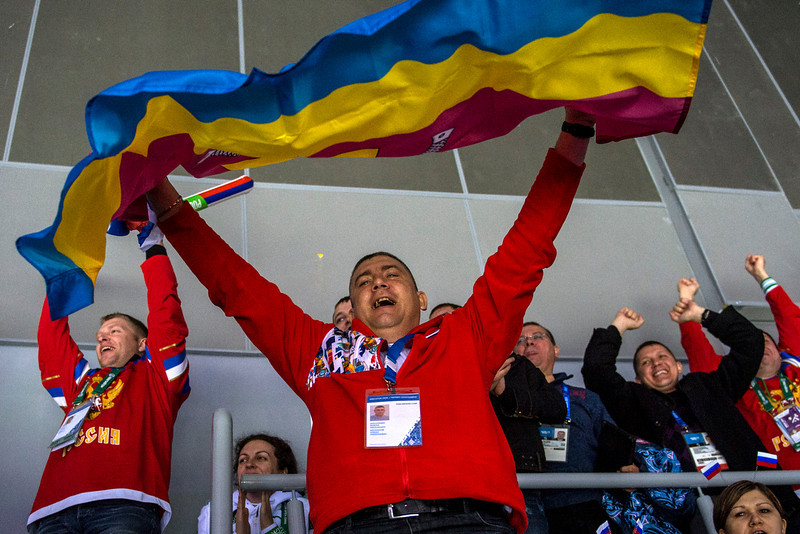 . Russian fans cheer after a goal during the game at Bolshoy Ice Dome during the 2014 Sochi Olympics Saturday February 15, 2014.  The United States men\'s hockey team defeated Russia with a 3-2 overtime victory. (Photo by Chris Detrick/The Salt Lake Tribune)