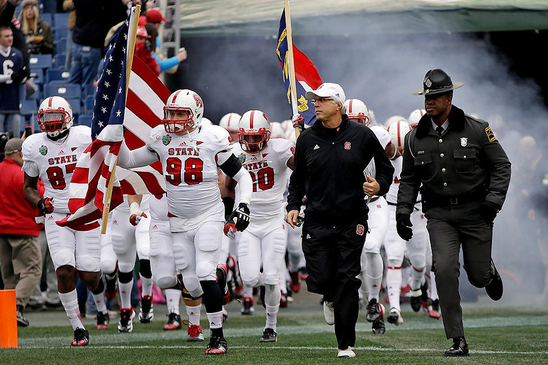 . North Carolina State defensive end McKay Frandsen (98) leads teammates onto the field for the Music City Bowl NCAA college football game against Vanderbilt, Monday, Dec. 31, 2012, in Nashville, Tenn. (AP Photo/Mark Humphrey)