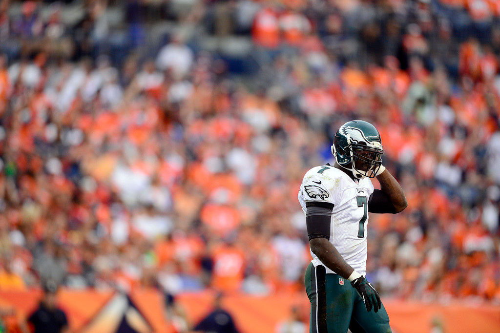 . Philadelphia Eagles quarterback Michael Vick (7) walks off the field to the bench during their loss against the Denver Broncos 52-20 September 29, 2013 at Sports Authority Field at Mile High (Photo by AAron Ontiveroz/The Denver Post)
