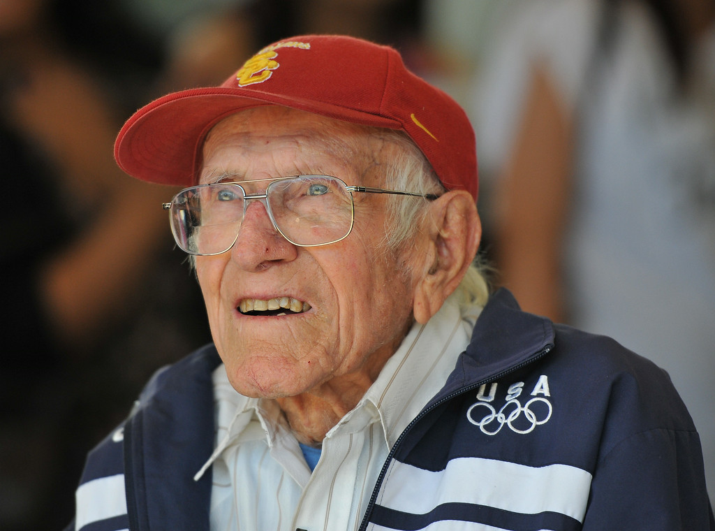 . Torrance legend Louis Zamperini paid a visit to his alma mater Torrance High to visit with alumni and meet students. Zamperini watches cheer leaders perform. (3/31/11) (Photo by Robert Casillas/Daily Breeze)