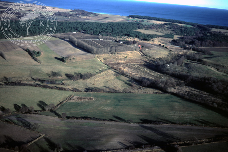 Farmland southeast Torups Gård showing the two valleys for Verkaån and Klammersbäck - with plantations and prehistoric remains (20 November, 1988). | LH.0300
