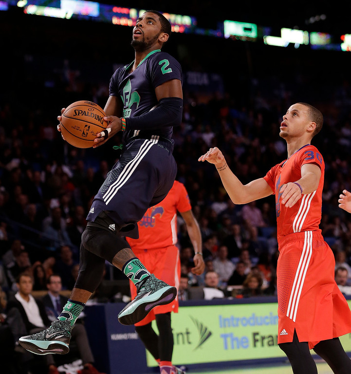 . East Team\'s Kyrie Irving, of the Cleveland Cavaliers (2) goes to the hoop against the West Team during the NBA All Star basketball game, Sunday, Feb. 16, 2014, in New Orleans. (AP Photo/Gerald Herbert)