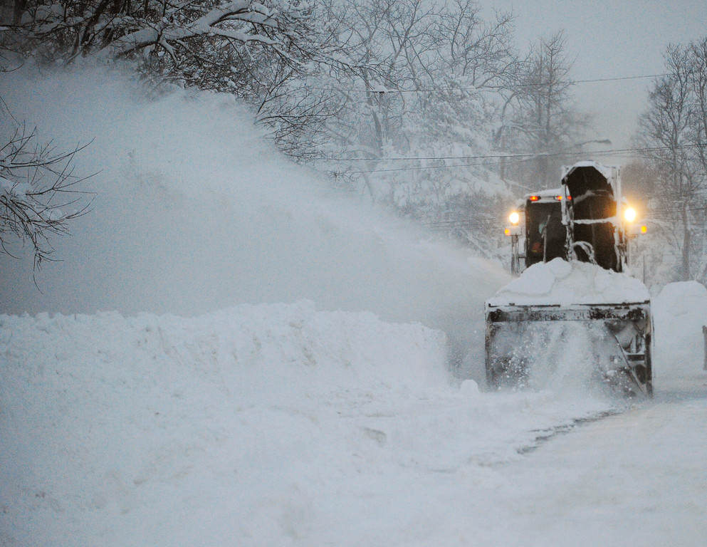 . A New York State snowblower removes snow on Broadway in Lancaster,  N.Y. Wednesday, Nov. 19, 2014. A ferocious storm dumped massive piles of snow on parts of upstate New York, trapping residents in their homes and stranding motorists on roadways, as temperatures in all 50 states fell to freezing or below.   (AP Photo/Gary Wiepert)