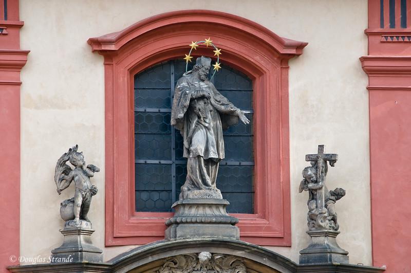 Statues adorn a building at Prague Castle