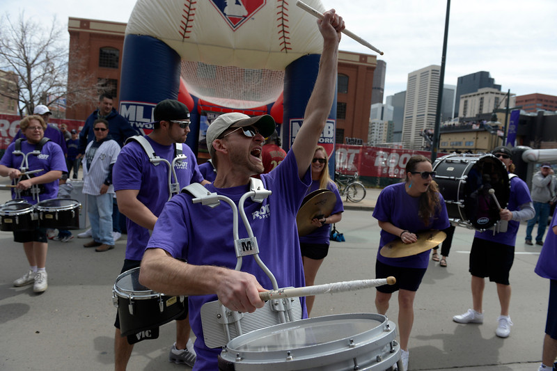 . Aaron Garrison with the Party Crashers Drumline helps pump up the crowd before the game. The Colorado Rockies hosted the Arizona Diamondbacks in the Rockies season home opener at Coors Field in Denver, Colorado Friday, April 4, 2014. (Photo by Craig F. Walker/The Denver Post)