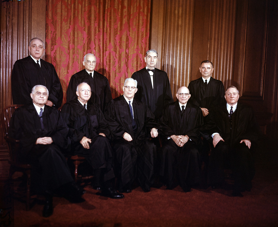 . Justices of the Supreme Court of the United States of America are shown in their judicial robes in Washington, D.C., on Jan. 29, 1957.  Seated from left are, Felix Frankfurter; Hugo Black; Earl Warren, chief justice; Stanley Reed; and William O. Douglas.  Standing from left are, John M. Harlan; Harold Burton; Tom Clark; and William J. Brennan.  (AP Photo)